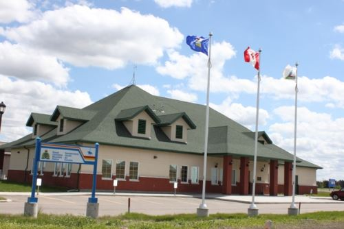 Town building with flag posts at entrance